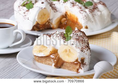 English Banoffee Pie On A White Plate Close-up Horizontal