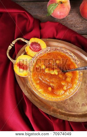 tasty apricot jam with fresh apricots on metal tray
