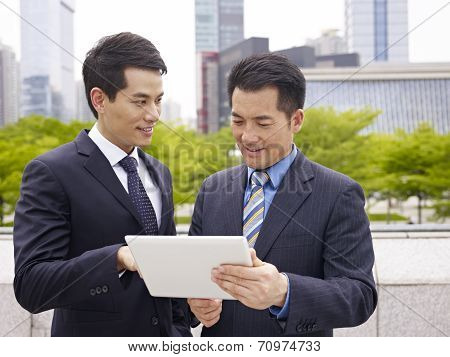 Asian Businesspeople Using Ipad