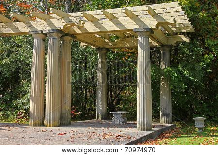 Old shaded arbor and Elegant stone bench in Seneca park.