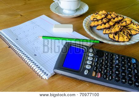 Workplace, Study Place With Calculator (with Blue Box), Workbook, Cup Of Coffee And Cookies
