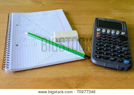 Workplace, Study Place With Calculator, Workbook And Pencil