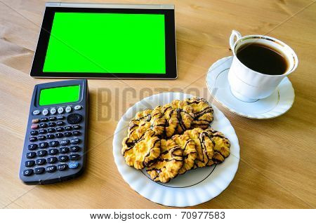 Workplace With Tablet Pc - Green Box, Calculator, Cup Of Coffee And Cookies