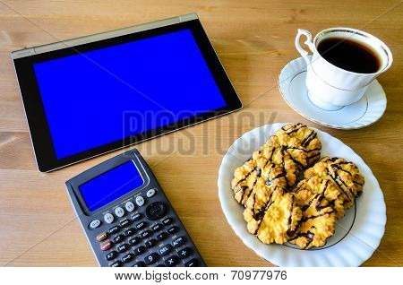 Workplace With Tablet Pc - Blue Box, Calculator, Cup Of Coffee And Cookies