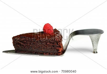 a slice of chocolate cake with raspberry