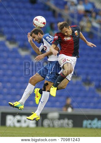 BARCELONA - AUG, 17: Giovanni Marchese of Genoa CFC vies with Christian Stuani of RCD Espanyol during a friendly match  at the Estadi Cornella on August 17, 2014 in Barcelona, Spain