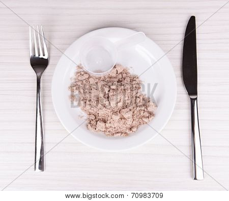 Whey protein powder on plate with scoop on wooden background
