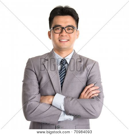 Portrait of Asian business man arms folded smiling, standing isolated on white background.