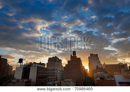 Sunset over NYC skyline and clouds