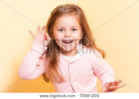happy little girl a on yellow background