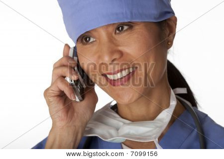 Medical Professional In Scrubs On The Phone. Isolated