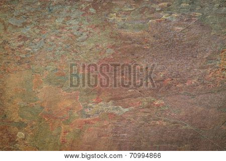 flat, multi color foliated slate rock with abstract  pattern