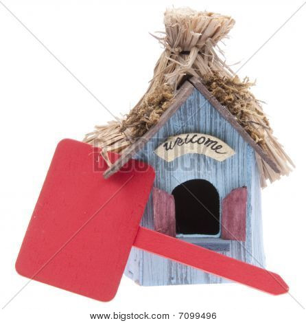 Small Home With Red Sign