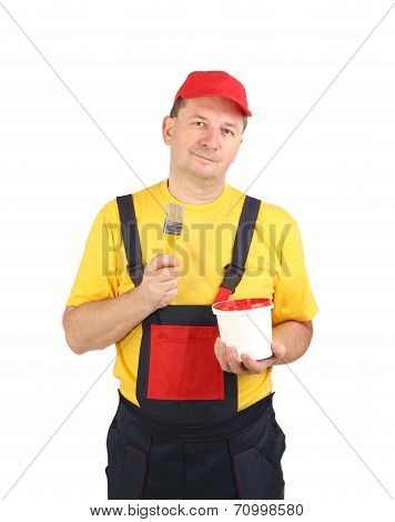 Worker in hat with paint brush.