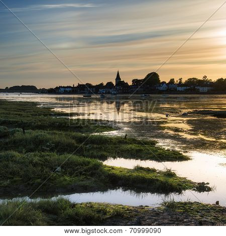 Beautiful Summer Sunset Landscape Over Low Tide Harbor With Moored Boats
