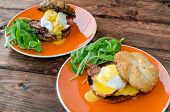 picture of benediction  - English muffin with bacon egg benedict with hollandaise sauce and arugula salad - JPG