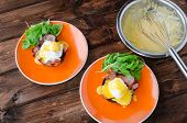 foto of benediction  - English muffin with bacon egg benedict with hollandaise sauce and arugula salad - JPG