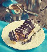 picture of eclairs  - Chocolate Eclairs And Cup Of Espresso - JPG