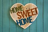 pic of paint palette  - Home Sweet Home message wooden heart from recycled old palette on turquoise painted background copy space - JPG