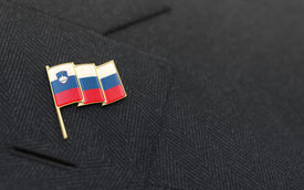 pic of lapel  - Slovenia flag lapel pin on the collar of a business suit jacket shows patriotism - JPG