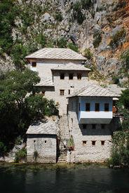 picture of sufi  - The historic Blagaj sufi monastery located at Vrelo Bune outside the village of Blagaj in the Herzegovina - JPG
