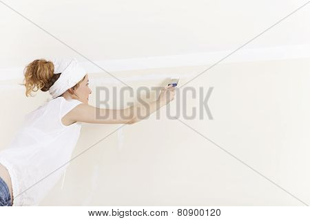 A Woman Painting Wall