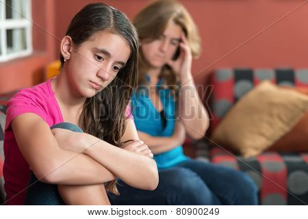 Teenager problems - Sad teenage girl and her worried mother