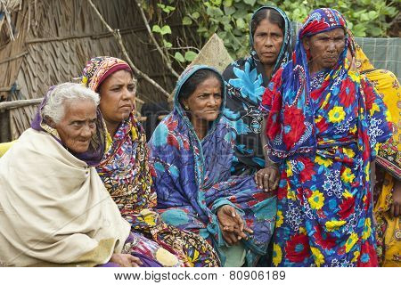 Women wait for their husbands from fishing in Mongla, Bangladesh.
