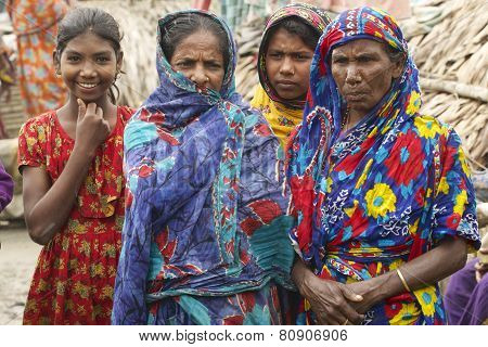 Women wait for their men from fishing in Mongla, Bangladesh.