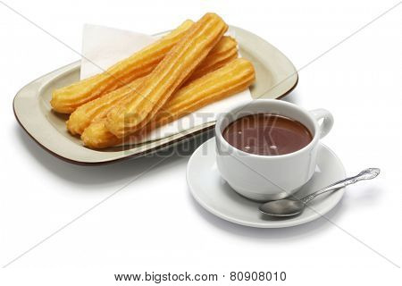 churros and hot chocolate on white background, spanish breakfast