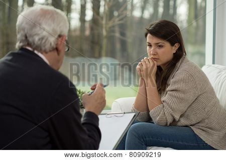 Sad Teenager Talking With Psychologist