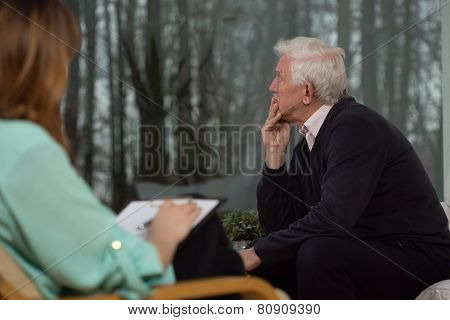 Sad Man Talking With Psychologist