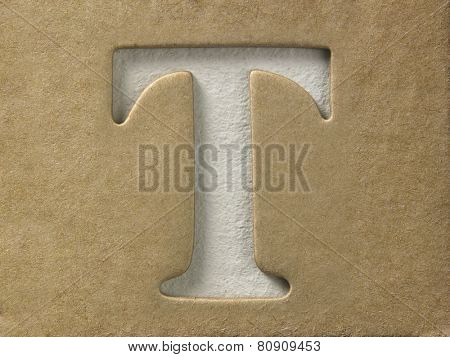 cut out alphabet t on the brown cardboard
