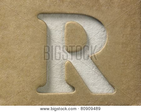 cut out alphabet r on the brown cardboard