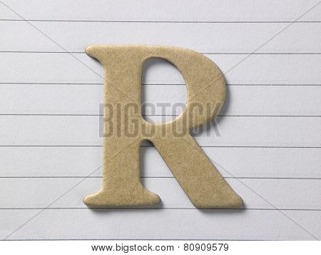 close up of alphabet r on single line book