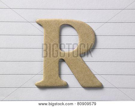 close up of alphabet r on single line book