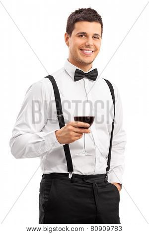 Handsome young guy drinking red wine isolated on white background