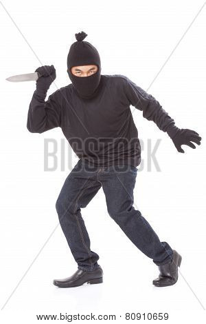 Man in a mask with a knife