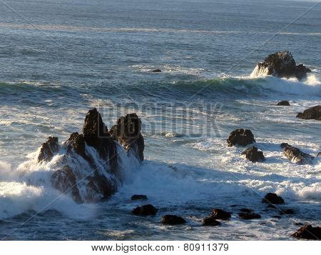 Waves crash on rocks