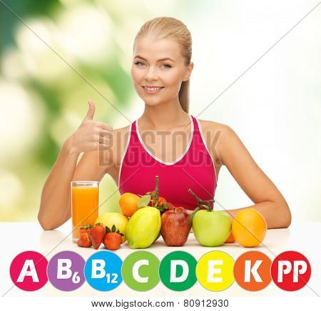 people, healthy eating, vegetarian and health care concept - happy woman with organic food and vitamins over green background