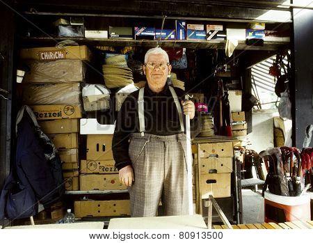Portrait Of A Senior Man In His Shop