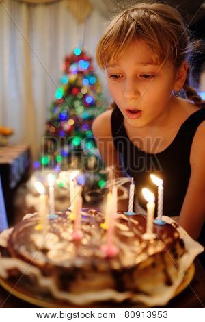 Girl celebrating birthday with cake