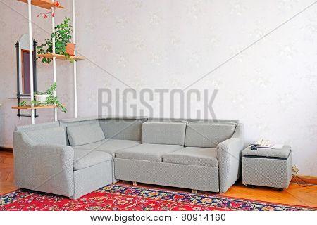 Corner sofa in a motel room