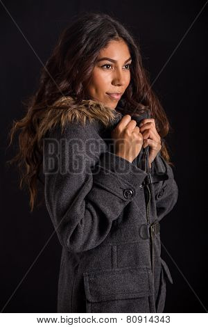 Beautiful exotic woman wearing fur lined peacoat