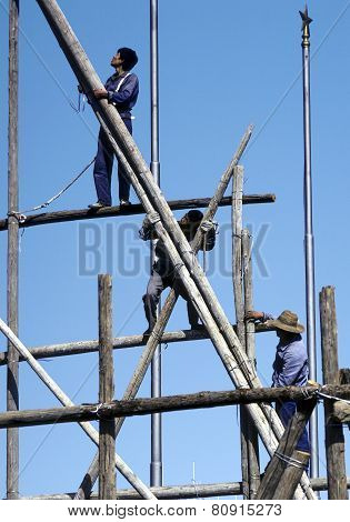 People Work On A Bamboo Scaffold In Beijing