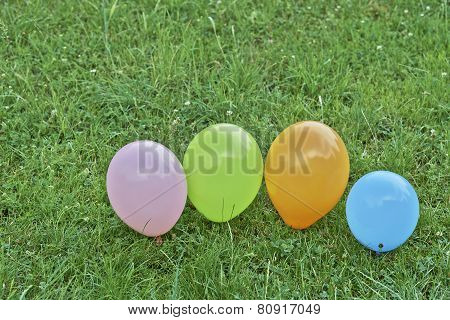 Balloons On The Grass