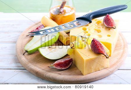 Cheese, Figs, Pear And Honey On Board