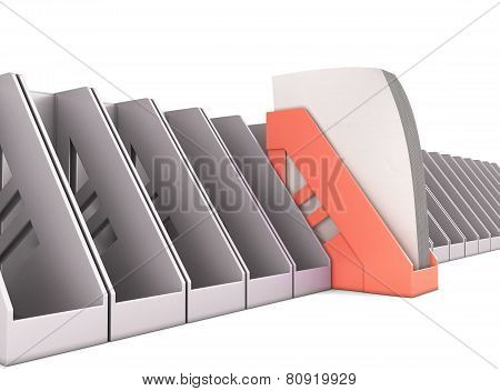 Red Paper Tray Stands Out Among The Gray Paper Trays