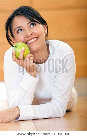 Pensive Woman With An Apple