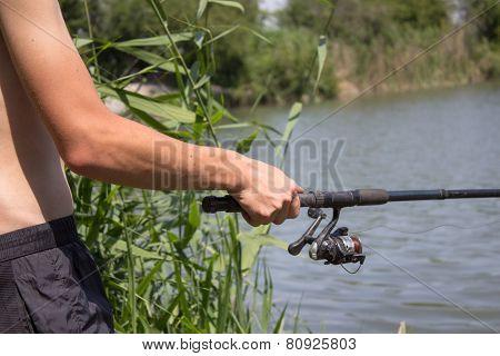 in hands of fishing rod Reel